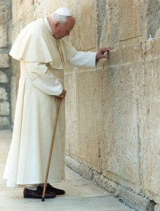 Pope John Paul II prays at the Western Wall in Jerusalem on March 26, 2000