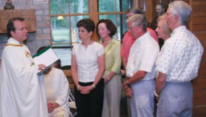 Chaplain Fr. Miles Walsh installs two new couples on June 24