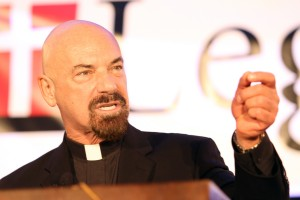 Fr. John Corapi makes a point at the Legatus Summit on Feb. 4