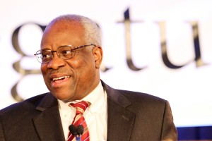 Justice Clarence Thomas enjoys a laugh at the Summit on Feb. 4