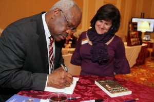 Justice Thomas signs his book for a Legatus member