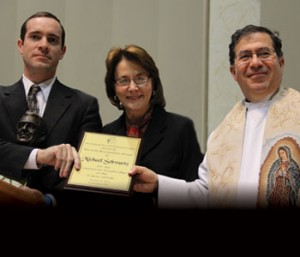 Joseph Schwartz (far left) accepts the Cardinal John J. O'Connor Pro-Life Award from Peggy Hartshorn (a member of Legatus' Board of Governors) and Fr. Frank Pavone on Jan. 25