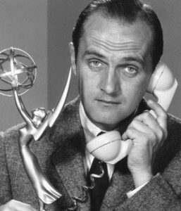 Bob Newhart poses with an Emmy in a promo shot for the 11th Emmy Awards, which aired on May 6, 1959 (NBCU Photo Bank)