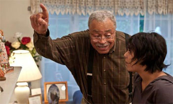 James Earl Jones (Father McCarthy) shares a scene with Vanessa Hudgens (Apple Baily) in Gimme Shelter