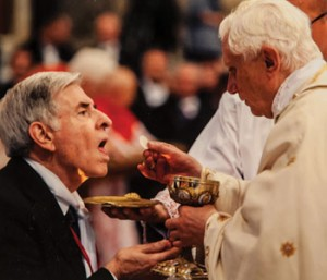 Dr. Gatz receives Communion from Pope Benedict XVI.