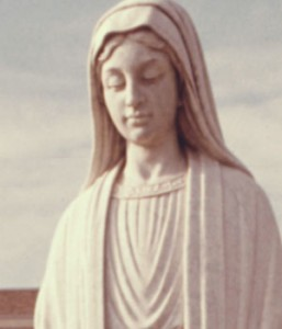 A statue of the Blessed Mother stands in front of Loretto Hospital in New Ulm, Minn.
