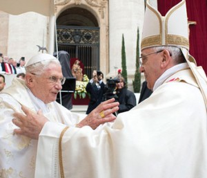 Pope Emeritus Benedict XVI embraces Pope Francis at the canonization Mass on April 27