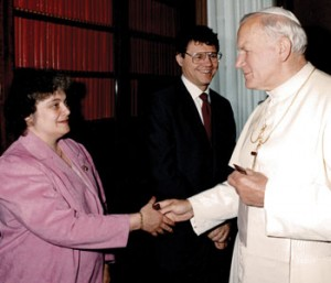 Legatus founder Tom Monaghan looks on while  St. John Paul II greets his wife Marjorie on May 7, 1987