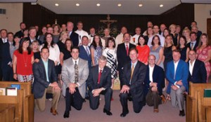 Legatus founder Tom Monaghan (center) with members of the Lafayette-Acadiana Chapter