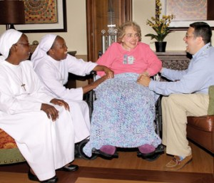 Legate Tom Moreland, president ofSt. Jude Hospice, and Sr. Rose and Sr. Clare meet with patient Lorraine McPherson in Des Moines, Iowa.