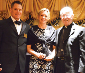 Paul and Sherry Green pose with Bishop Conlon