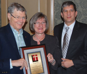 Legatus founder Tom Monaghan presents Chris and Mary Anne Yep with Legatus' Courage in the Marketplace award