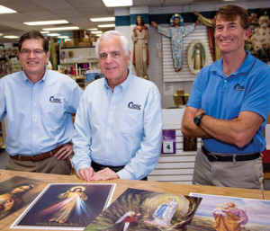 Mike, Tim and Patrick Cotter pose in front of prints they sell at their Los Angeles headquarters.