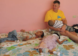 Dr. Richard Ohnmacht, holds a child at the Hogar Immanuel Orphanage in the Dominican Republic