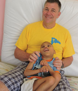 Dr. Richard K. Ohnmacht, a member of Legatus' Providence Chapter, holds a boy at the Hogar Immanuel Orphanage