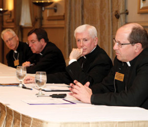 Grand Rapids Bishop David Walkowiak (far right) speaks during a panel discussion with Bishop Earl Boyea, Archbishop Allen Vigneron and Bishop Daniel Thomas (Patrick Novecosky photos)