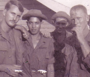 Manny Montanez, third from the left, poses members of his platoon in September 1968 at their base camp in Cu Chi, South Vietnam.