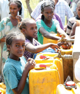 Girls fill their containers of water at a community well near Meki, Ethiopia.
