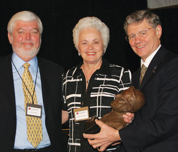Jim Hughes, with his wife Virginia, receive the Cardinal John J. O'Connor Pro-Life Award from Tom Monaghan on Feb. 3, 2007