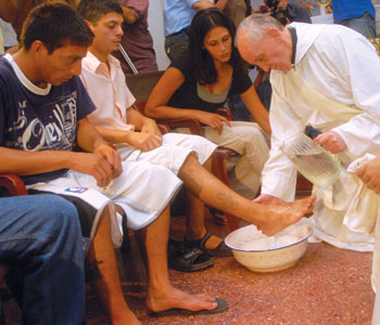 Then-Cardinal Jorge Mario Bergoglio washes the feet of patients at a shelter for drug users during a Holy Thursday Mass in Buenos Aires on March 20, 2008 (REUTERS/Enrique Garcia Medina photo)