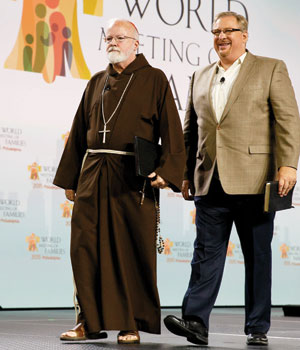 Boston Cardinal Seán O'Malley and Rick Warren take the stage at the World Meeting of Families in Philadelphia on Sept. 25 (Gregory L. Tracy photo)