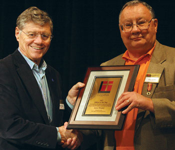 Legatus founder Tom Monaghan presents Genesis Legate James Shrader with the 2007 Officer of the Year Award on Feb. 1, 2008