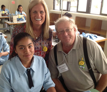 Steve and Debbie Peroutka of Legatus' Baltimore Chapter with a student at Girlstown