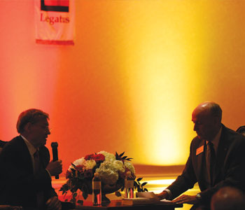 "Legatus founder Tom Monaghan and Legate Hank Christ engage in a ""fire-side chat"" at the chapter's May 31 chartering event"