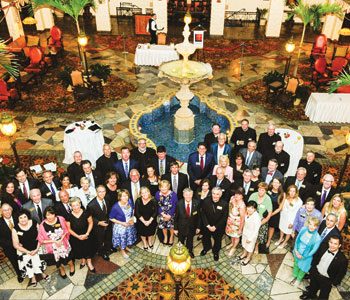 Charter members of Legatus' Harrisburg Chapter gather with Bishop Ronald Gainer and Tom Monaghan at the Hershey Hotel in Hershey, Pa., on May 31 (Chris Heisey photos)