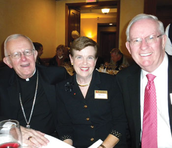 John and Kathie Hunt share a laugh with retired Chicago auxiliary Bishop John Vlazny in 2011