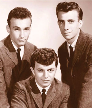The Belmonts in 1959. L-R: Carlo Ma strangelo, Dion DiMucci, Fred Milano. Not shown is Angelo D'Aleo,who was serv ing in the U.S. Armed Forces when this photo was taken